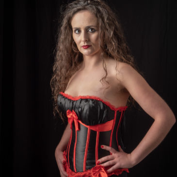 Black and red corset in studio